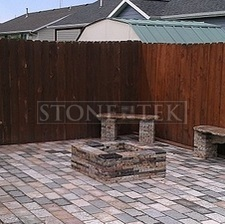 Mixed Blend pavers with Garden benches and square fire pit.
